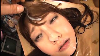 Cute Japanese girl welcomes a huge load of semen on her face