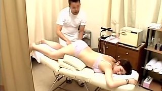 Doggystyle Japanese fucking in the masseur.s office