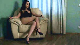 Dominant dark-haired beauty in high heels walks over her
