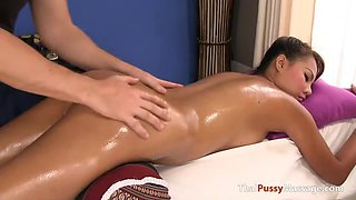 Busty Thai chick gets oiled pussy massage