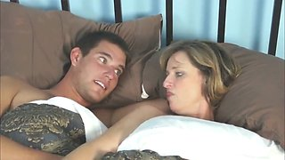 mom and son share bed in hotel when go travel