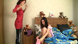 Girls fooling around in bed