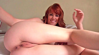 Redhead is seen reaching an orgasm twice in this scene