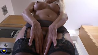 Long haired elegant blonde bombshell Lena Love strips in the kitchen