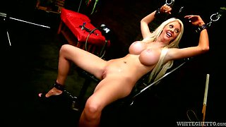Handcuffed naked busty blondie is massaged with a Hitachi tool