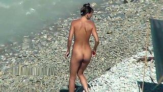 Cute teen nudists on the beach