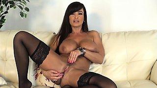 Big breasted cougar in black stockings Lisa Ann masturbates on camera