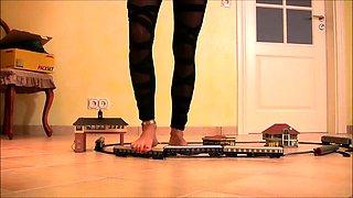 Slender blonde in high heels puts her wonderful feet to work