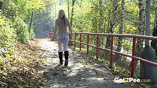 Sexy Blonde In Black Boots Pisses By Road