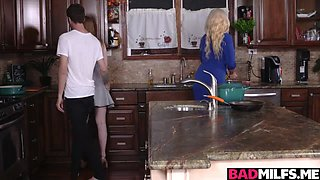 Blonde cougar and her hot step daughter are taking care of an stud with a hard cock in the kitchen