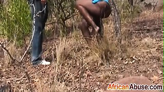 African whore gets mouthfucked by two dudes outdoors