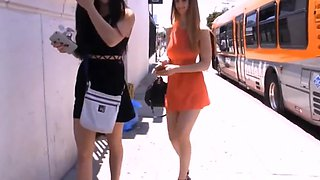 Girls defiles on the street showing off their asses
