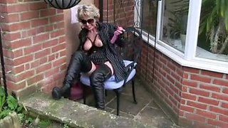 Milf in boots enjoys public gloryhole blowjob