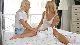 Pair of golden-haired lesbians using their most favorite sex toy