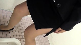 Asian whore pisses toilet