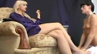 mistress enjoying feet worship relaxing on sofa