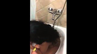 Amateur ebony slut gets covered in hot piss in the shower