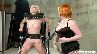 Submissive blonde April Showers abused by redhead Mistress Irony