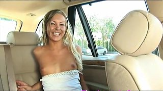 Cutie in the back of the car spreads and masturbates