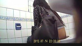 Long hair brunette woman spied in public toilet
