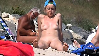 Horny voyeur captures gorgeous babes on the nudist beach