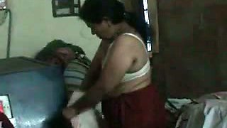 My Indian mature auntie changing her dress on home video