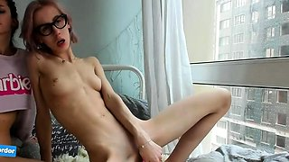 Two beautiful young lesbians masturbate together on webcam