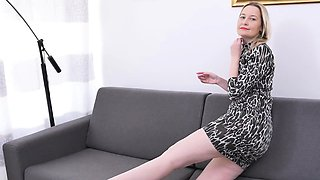 Blonde mature rubs her pussy on the couch