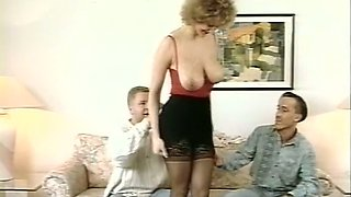 Busty and horny white curvy milf on the bed with two men