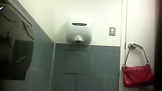 Woman squatting over toilet and pissing