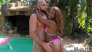 Ebony babe with a big booty gets rammed by the pool