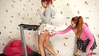 Two funny chicks are touching each other at the gym