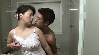 Mature Asian mom sucking a hot young cock hard