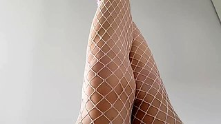 Sexy babe in fishnets and high heels touches herself in POV