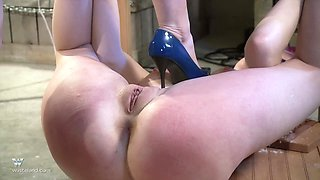 Redhead mistress wants to punish a sweet girl with sex toys
