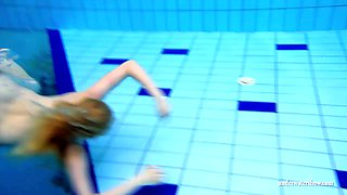 Blonde European sweetheart shows off her body underwater