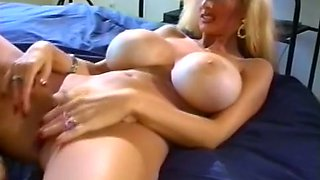 Sizzling hot and busty blondie dresses up for her loyal fan
