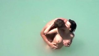 Voyeur tapes a couple at a nude beach making-out