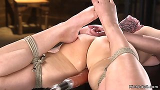 Solo brunette fucks machine in dungeon