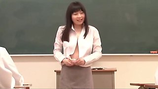 Asian teacher bows before schoolgirls