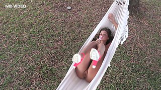 Sex-hungry hottie Maria Rya is playing with her pussy in a hammock