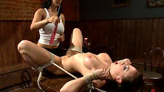 Hot Brunette Gets a Strapon Anal Fucking From a Gorgeous Dominatrix