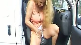 Blonde German milf masturbates in the car outdoors