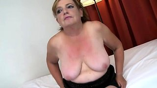 Curvy granny in stockings has a young guy drilling her pussy