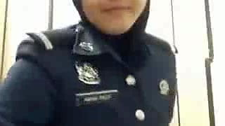 arab police woman taking her hijab out and show her booty