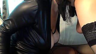 Busty dominatrix in lingerie punishes her slave's fiery ass
