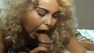 Chubby and cute blonde girl in the bedroom feeding on a dick