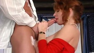 Stunning redhead busty milf gets on her knees to suck big dick